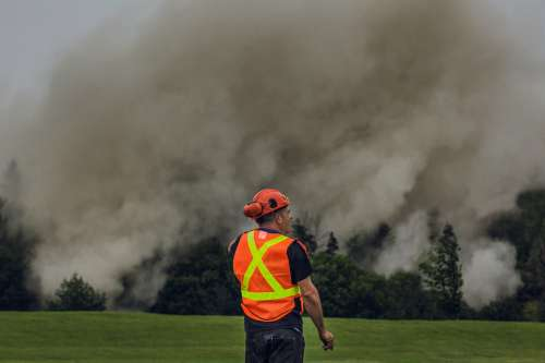 Construction_Man_In_Front_Of_Smoke Photo