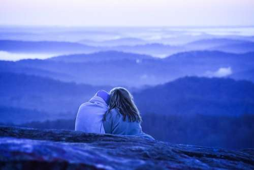 Couple Cuddles Watching Over Nature Photo