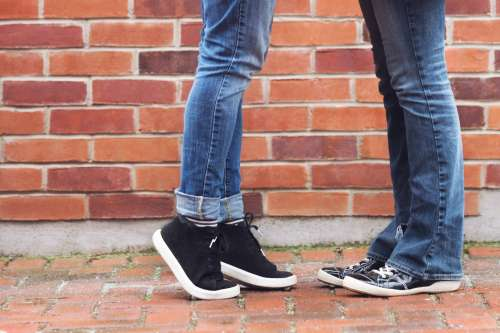 Couple Tip Toes Face To Face Photo