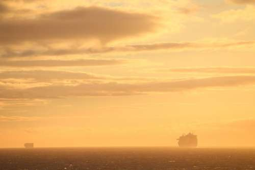 Cruise Ship Silhouette At Sunset Photo