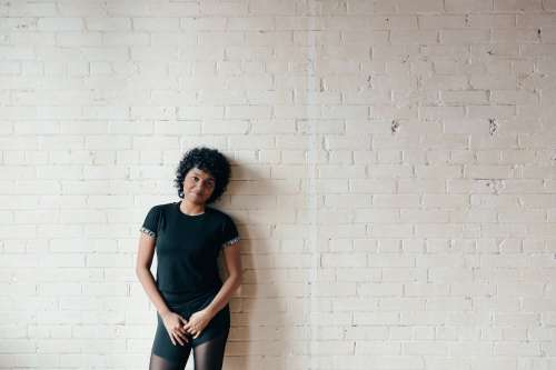 Curly Haired Woman Bricks Photo