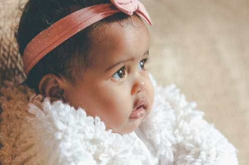 Cute Baby Girl With Pink Bow Headband Photo