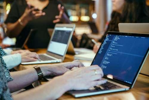 Developer Coding On Laptop Photo