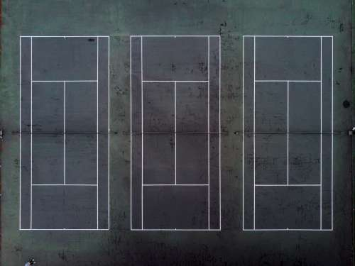 Drone View Of Three Tennis Courts Photo