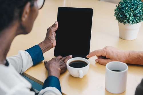 Elderly Hands Holding iPad Photo