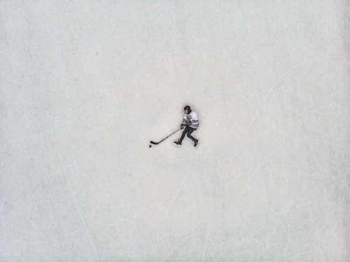 Flat Lay View Of Hockey Player Against The Ice Photo