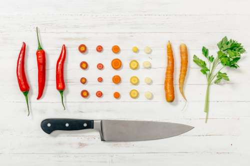Flatlay With Knife And Vegetables Photo