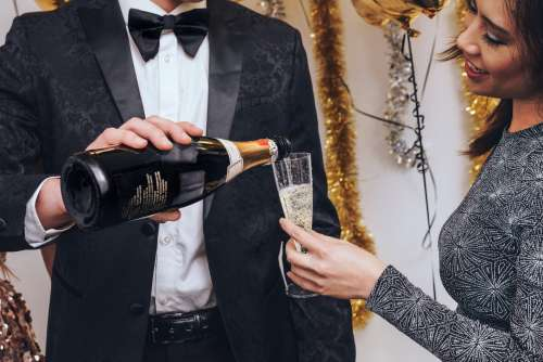 Formal Party Pouring Champagne Photo