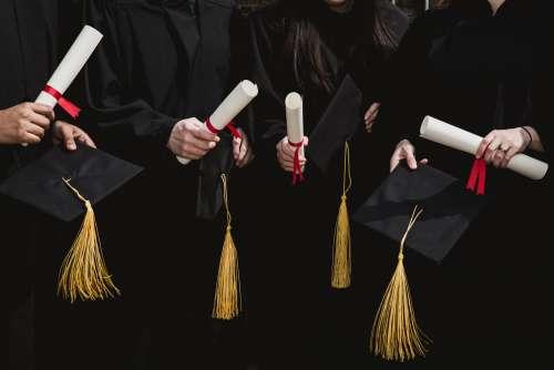 Four Grad Students Caps And Diplomas Photo