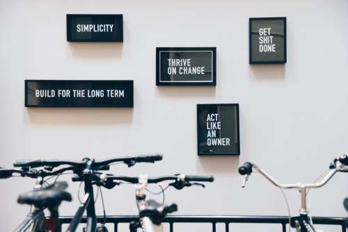 Framed Quotes Behind Bike Rack Photo
