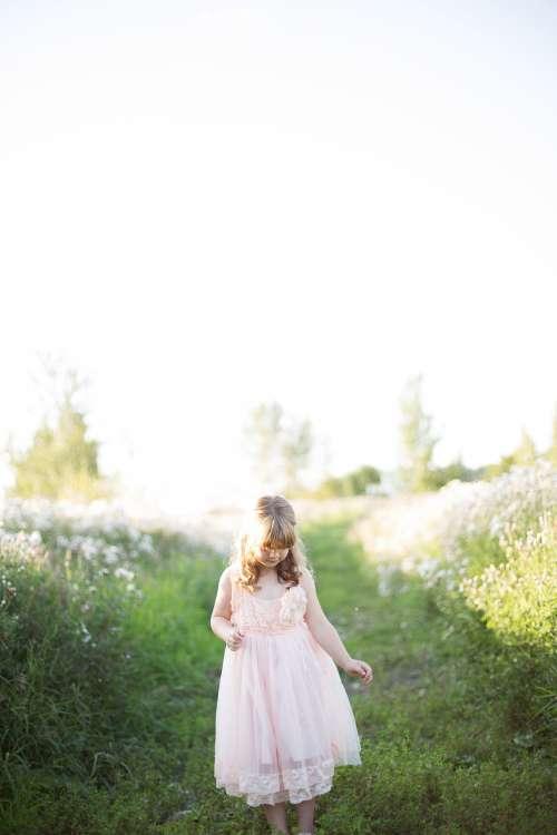 Girl On Grassy Path Photo