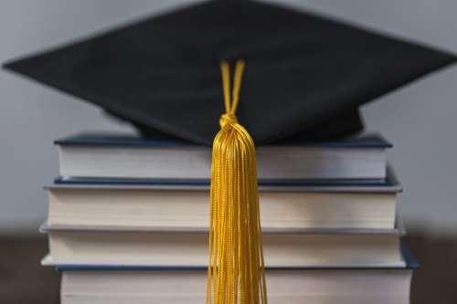 Graduation Cap Gold Tassle And Books Photo