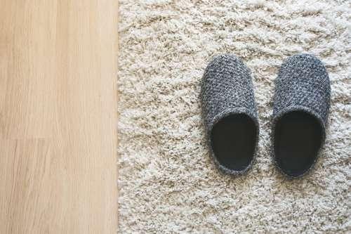 Grey Slippers On Carpet Photo