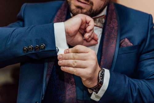 Groom Adjusting Cufflinks Photo