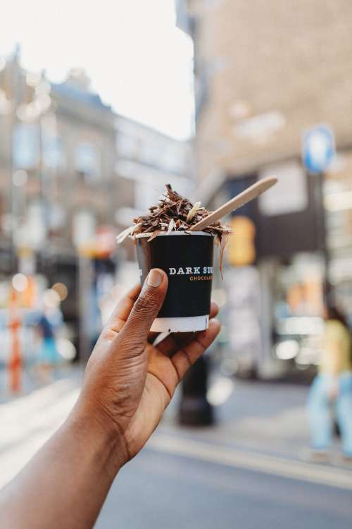 Hand Holding Cup Of Chocolatey Delicious Photo