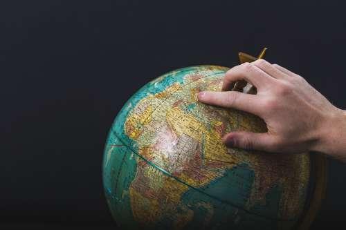 Hand Points On Globe Photo