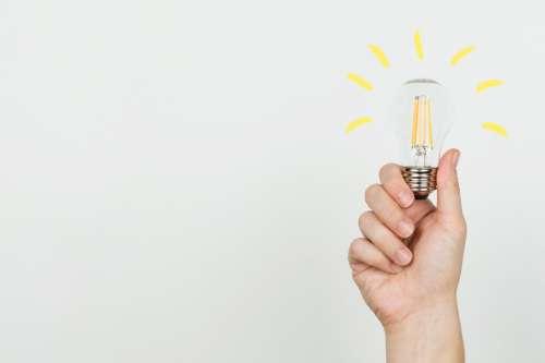 Hand With Idea Lightbulb Photo
