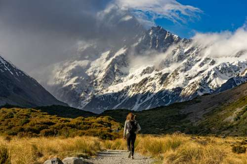 Hiker Approaches Snow-capped Mountains Photo
