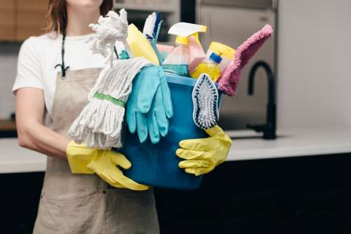 Holding Bucket Of Cleaning Supplies Photo