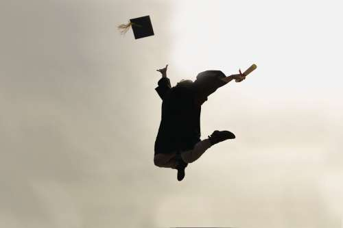 Jumping Grad Student Celebrating Photo