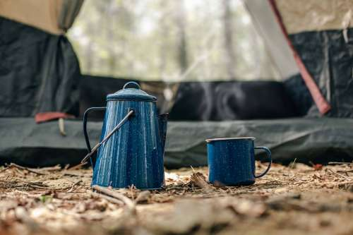 Kettle And Cup In Front Of Tent Photo