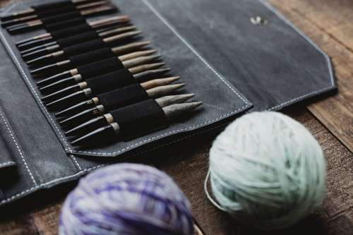 Knitting Needles And Yarn On A Wooden Table Photo