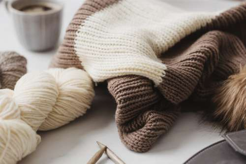 Knitwear, Yarn, And A Mug Of Coffee Photo