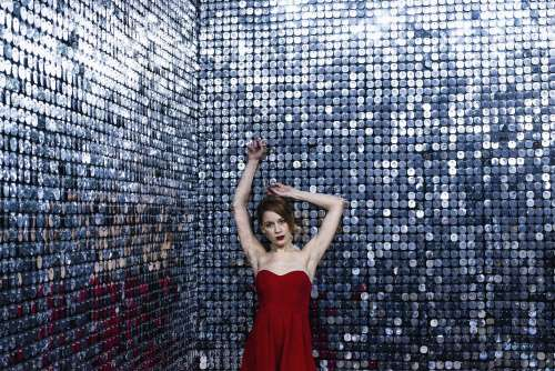 Lady In Red With A Mirror Sequin Backdrop Photo