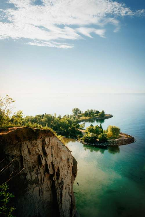 Lakeside Cliffs And Blue Sky Photo