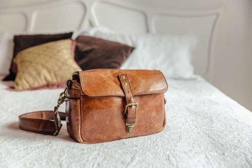 Leather Handbag On Bed Photo