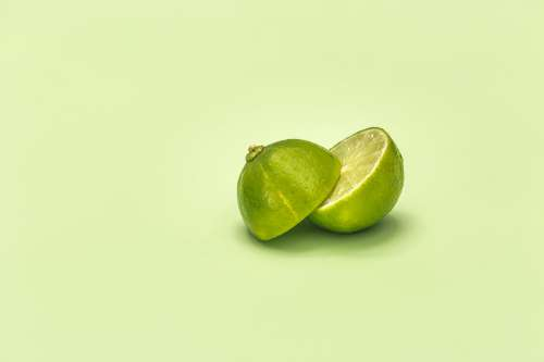 Lime Cut In Half On Green Surface Photo