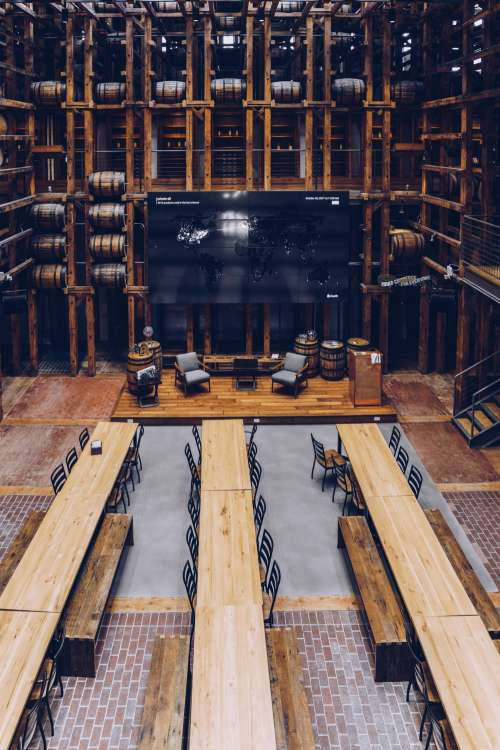 Long Wooden Tables In Hall From Above Photo