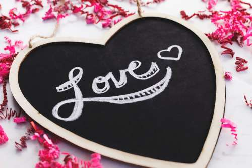 Love Written On A Heart-Shaped Blackboard Photo