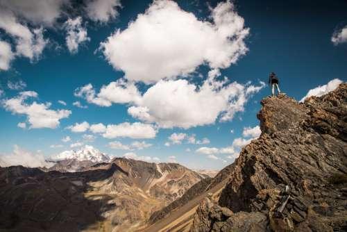 Man-Goat Climbing Rocks Photo