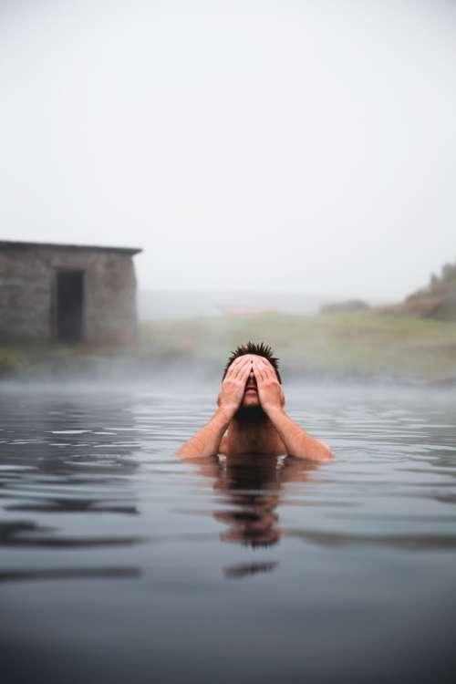 Man In Volcanic Pool Photo