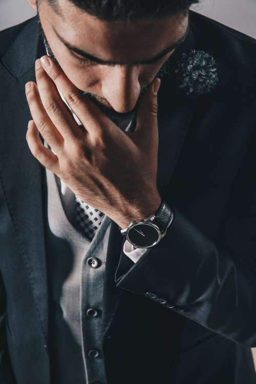 Man Looking Down In Suit Photo