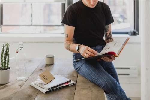 Man Reads Book In Studio Photo