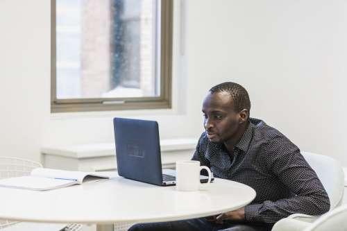Man Watches Laptop Photo