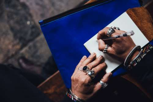 Man With Rings Writing Photo