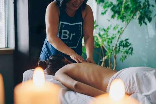 Massage Therapist Treating Woman Photo