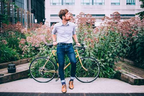 Men's Fashion Man In Shirt And Jeans Leaning On Bicycle Photo