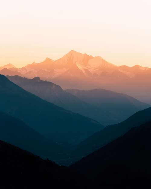 Misty Mountain Ranges At Sunrise Photo