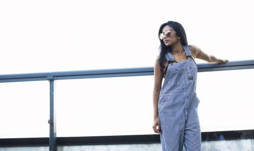 Model In Overalls On Bright Day Photo