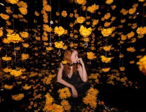 Model Poses With Hanging Flowers Photo