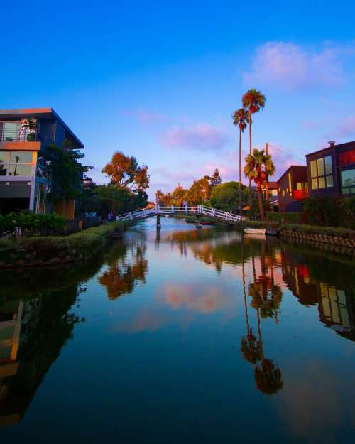 Modern Houses On A Vibrant River Photo