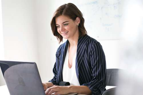 Modern Woman At Laptop Working Photo