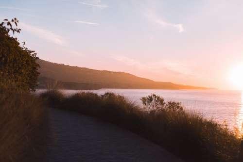 Morning Sun Illuminates The Hills In The Distance Photo