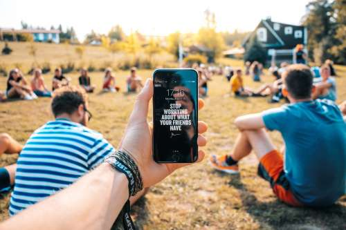 Motivational Message On Mobile At Outdoor Event Photo