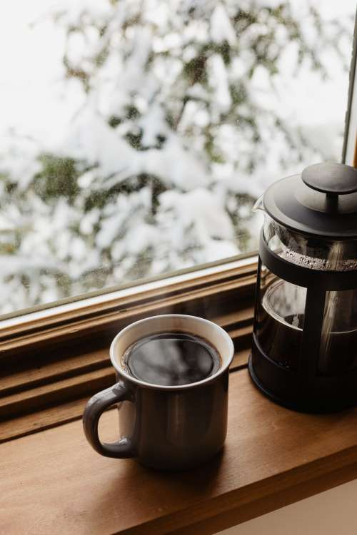 Mug Of Coffee And A French Press On A Window Sill Photo