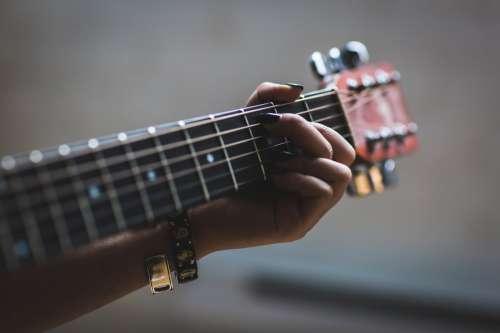 Musician Playing Guitar Photo